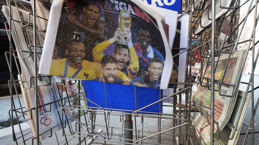 front cover : PARIS, FRANCE - JUL 16, 2018: Man buying Le Figaro newspaper announcing France champion title after French national football team won their FIFA World Cup 2018 final game against Croatia in Moscow