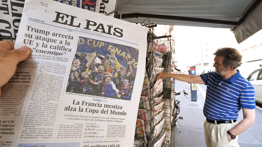 front national : PARIS, FRANCE - JUL 16, 2018: Man buying El Pais newspaper announcing France champion title after French national football team won their FIFA World Cup 2018 final game against Croatia in Moscow