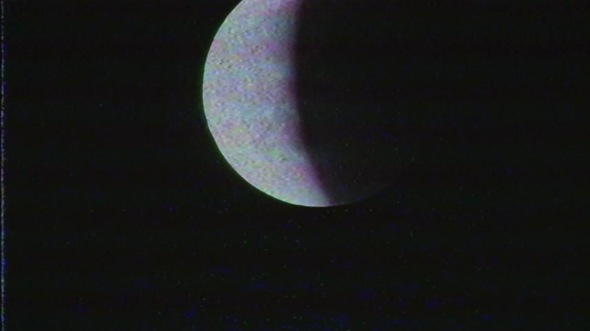astroloji : Vintage VHS tape film effect over the total lunar eclipse Stok Video
