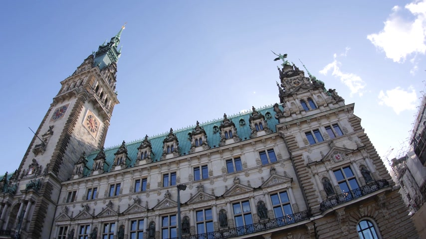 rathaus : HAMBURG, GERMANY - CIRCA 2018: Ultra wide angle of the majestic Hamburg City Hall Hamburger Rathaus facade the seat of local government of the Free and Hanseatic City of Hamburg with pedestrians