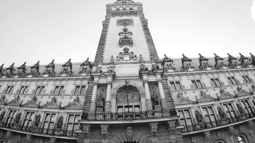 rathaus : HAMBURG, GERMANY - CIRCA 2018: Tilt-up ultra wide angle of the majestic Hamburg City Hall Hamburger Rathaus facade the seat of local government of the Free and Hanseatic City of Hamburg - black and white