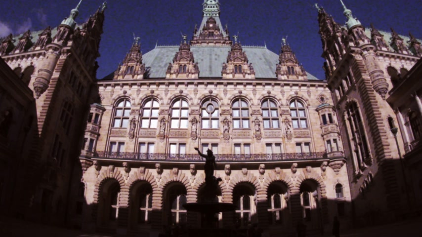 rathaus : Vintage VHS effect over the courtyard is decorated with a Hygieia fountain in majestic Hamburg City Hall Hamburger Rathaus facade the seat of local government of the Free and Hanseatic City of Hamburg Stock Footage
