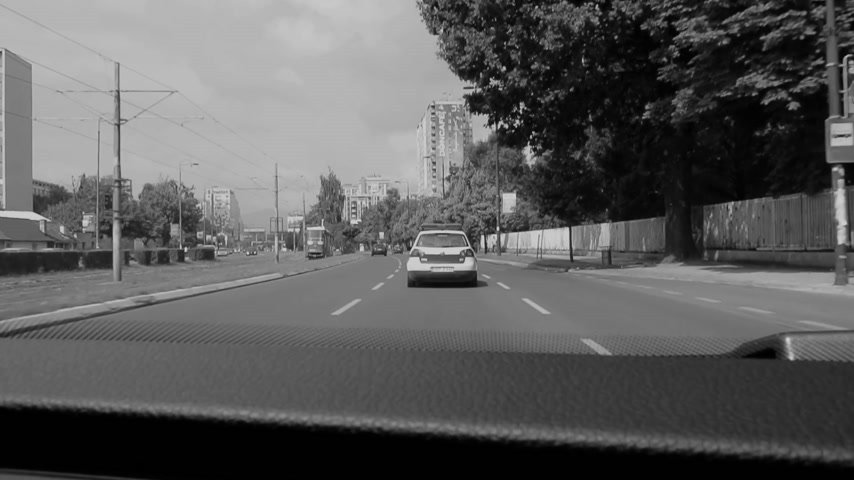 special police : Sarajevo, Bosnia and Herzegovina - Circa 2018: View point from inside official delegation vehicle driving behind police car in Sarajevo city center official convoy - black and white