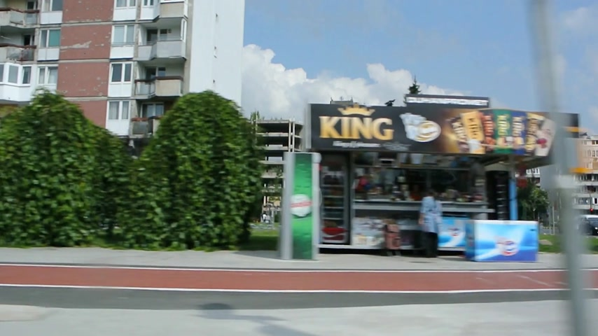 balkan : Sarajevo, Bosnia and Herzegovina - Circa 2018: View on typical Yugoslav residential buildings and shops as seen from inside a vehicle driving on the streets of Sarajevo