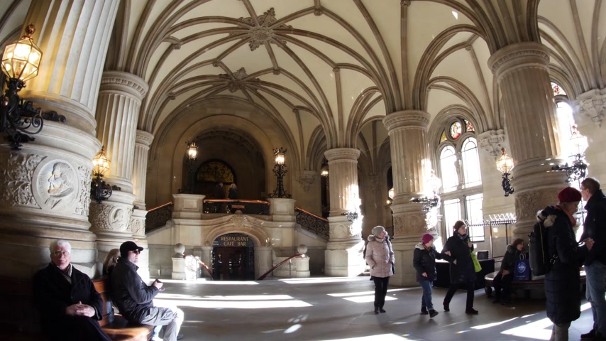 rathaus : HAMBURG, GERMANY - CIRCA 2018: Ultra wide angle of the majestic Hamburg City Hall Hamburger Rathaus interior with tourists travelers admiring the architecture details