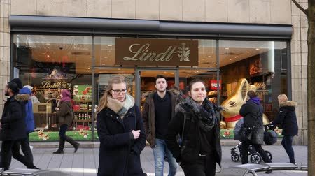 showcase : HAMBURG, GERMANY - CIRCA 2018: Lindt & Sprungli chocolate sweets store in central Hamburg on the Spitalerstrasse with people customers entering the sweets food store