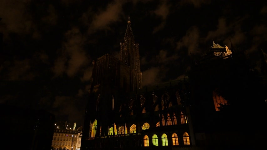 dom : STRASBOURG, FRANCE - CIRCA 2018: Strasbourg Notre-Dame Cathedral building projection on the facade mapping light show during annual light show