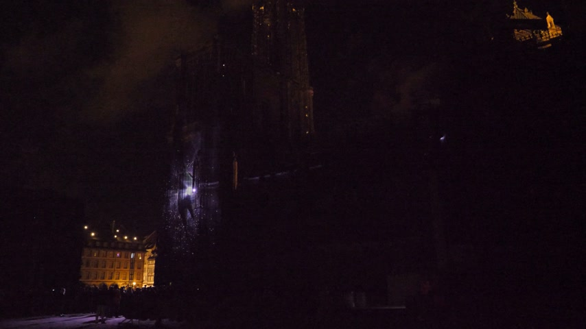 romanesk : STRASBOURG, FRANCE - CIRCA 2018: Time-lapse fast motion Strasbourg Notre-Dame Cathedral building projection on the facade mapping light show during annual light show