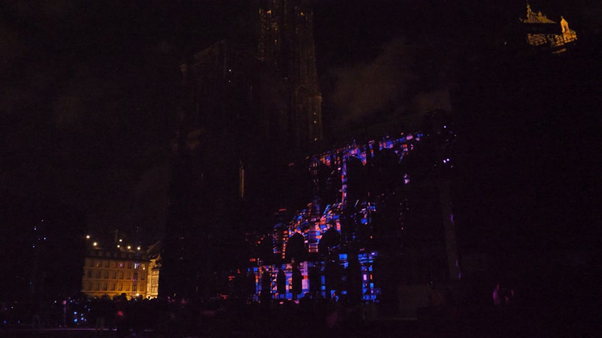 strasburg : STRASBOURG, FRANCE - CIRCA 2018: Strasbourg Notre-Dame Cathedral building projection on the facade mapping light show during annual light show