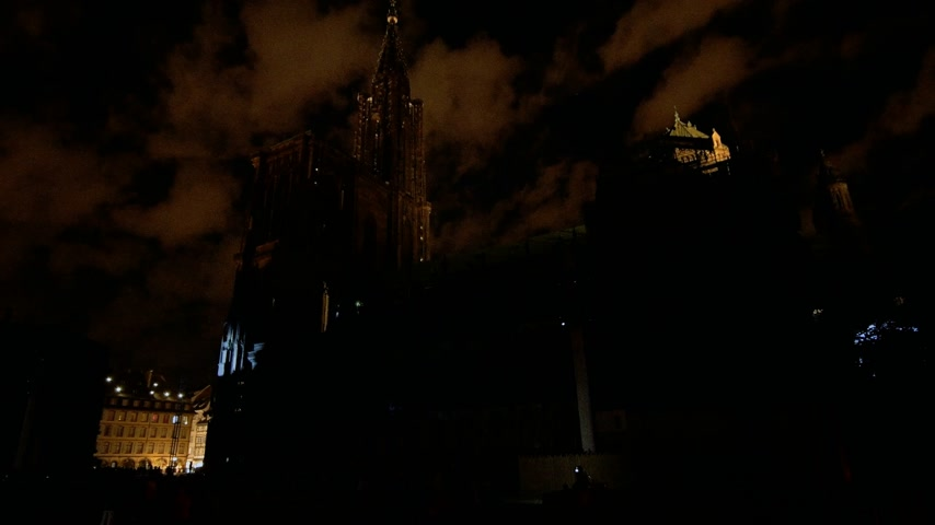strasburg : STRASBOURG, FRANCE - CIRCA 2018: Luxury Strasbourg Notre-Dame Cathedral building projection on the facade mapping light show during annual light show