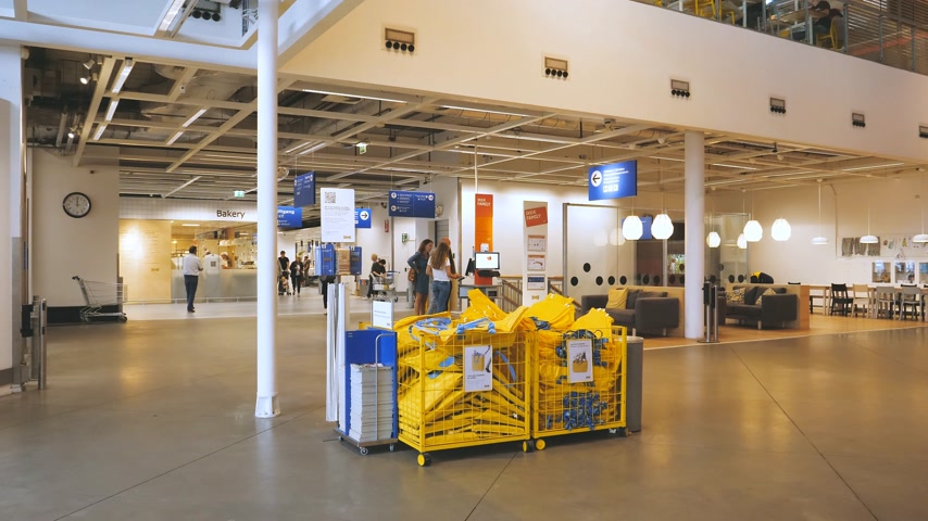 ikea : DELFT, NETHERLANDS - CIRCA 2018: Box with FRAKTA YPPERLIG Shopping bag for customers in big box - wide view of interior