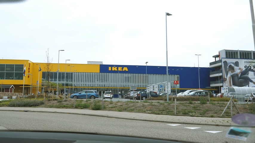 ikea : DELFT, NETHERLANDS - CIRCA 2018: Car point of view pov driving to Ikea furniture store large parking