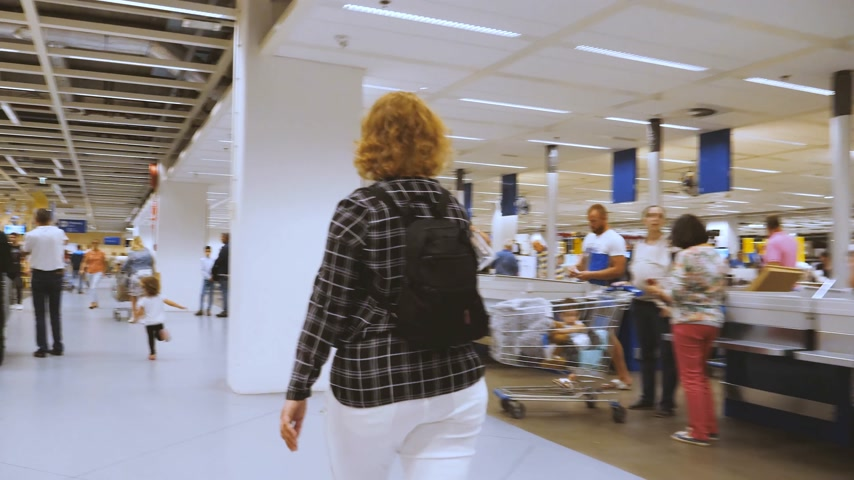 супермаркет : DELFT, NETHERLANDS - CIRCA 2018: Customer POV in the IKEA furniture store walking near cashiers area