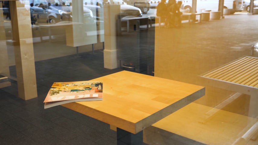 katalog : DELFT, NETHERLANDS - AUG 23, 2018: Ikea furniture catalogue magazine on the table made by IKEA - view from the street through glass inside store - newsworthy
