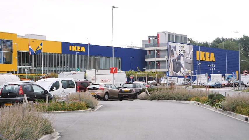 everything : DELFT, NETHERLANDS - CIRCA 2018: Slow motion cinematic news footage of Renault Clio car heading toward IKEA furniture warehouse store parking
