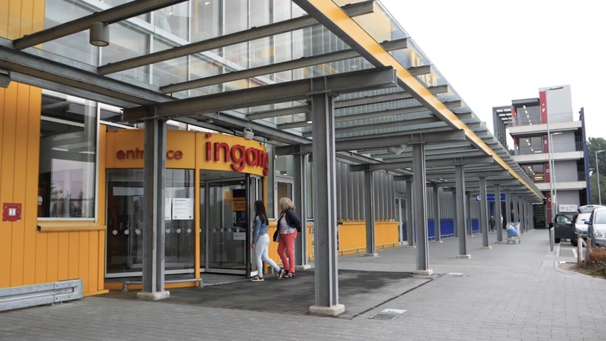 everything : DELFT, NETHERLANDS - CIRCA 2018: Customers in front of the IKEA furniture store large yellow facade with Ingang - translated as Entrance large sign - slow motion