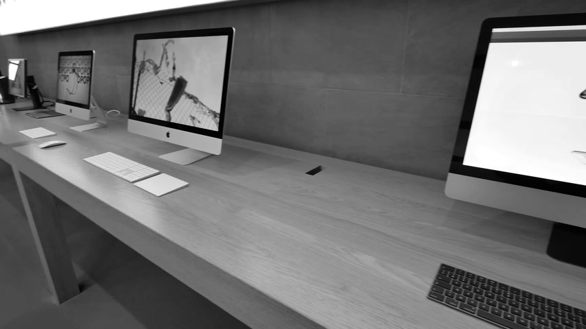 intel : STRASBOURG, FRANCE - CIRCA 2018: New iMac Pro the all-in-one personal computer in Apple Computers Store with website of Apple showcasing the home page with new iPhone X s and new iPad - black and white Stock Footage