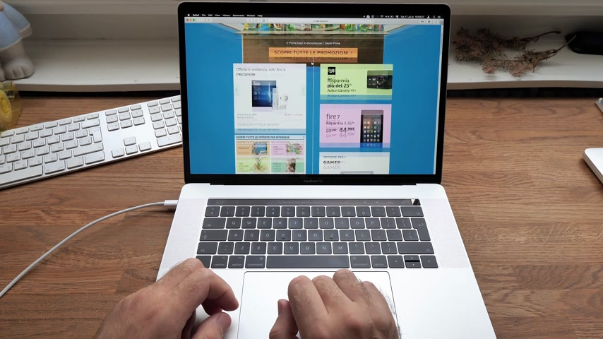 amazon prime : PARIS, FRANCE - JUL 16: Man hands POV scroll shopping on Apple MacBook Pro 15 laptop with Safari Internet browser open to Amazon Prime Day special deals discounts - online consumerism shopping