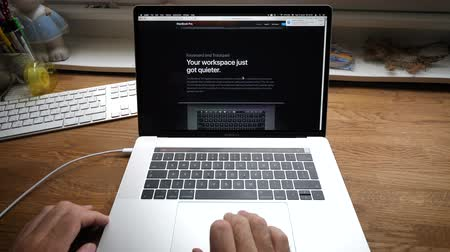 intel : PARIS, FRANCE - CIRCA 2018: Man hands POV scrolling Apple Website on MacBook Pro 15 Safari browser with latest 2018 Intel 8th GEn CPU and 32 GB RAM and 4tb NVME SSD