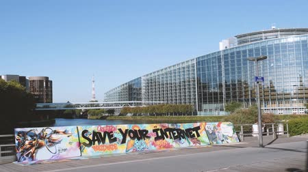 hashtag : STRASBOURG, FRANCE - SEP 12, 2018: Wide image of  large protest banner Save Your Internet with European parliament in the background and pedestrians walking