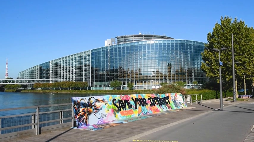 neutrality : STRASBOURG, FRANCE - SEP 12, 2018: Wide image of  large protest banner Save Your Internet with European parliament in the background