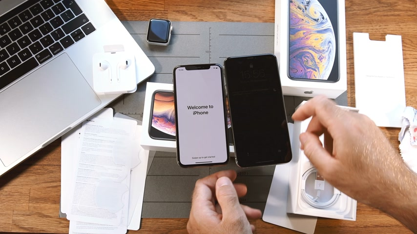 settings : PARIS, FRANCE - SEPTEMBER 21, 2018: Welcome to iPhone Xs and Xs max unboxing on vlogger table - view from above with all the settings of the newest smartphone telephone Stock Footage
