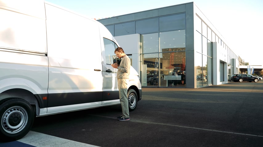 volkswagen : LYON, FRANCE - CIRCA 2018: Curious Caucasian young customer admiring the price and interior of the white Volkswagen Crafter transporter van  time lapse fast motion
