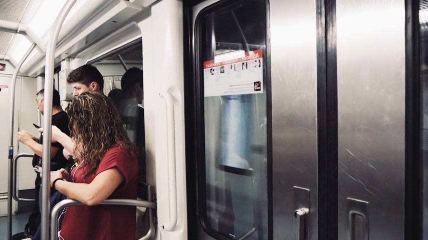 ticket machine : BARCELONA, SPAIN - CIRCA 2018: Commuters inside Barcelona Metro train - people with different ages travel in modern trains to destination using mobile phones smartphones - slow motion footage Stock Footage