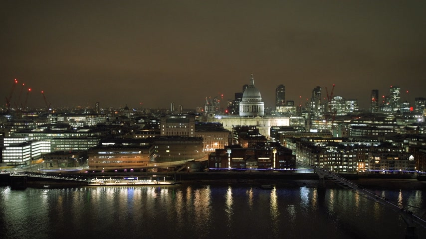 martwa natura : British London still drone aerial view of Anglican St Pauls Cathedral the seat of the Bishop of London and Millennium Bridge and magical Thames river skyscrapers in the background - night scene