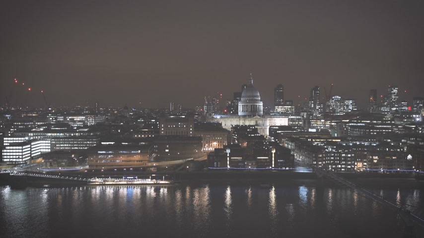 контрасты : Night scene of British London still drone aerial view of Anglican St Pauls Cathedral the seat of the Bishop of London and Millennium Bridge and magical Thames river skyscrapers in the background - faded colors