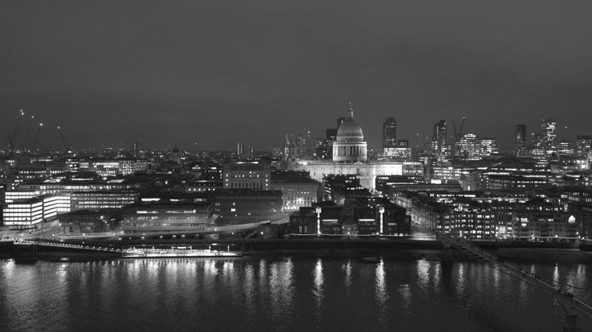 havadan görünüş : Night scene of British London still drone aerial view of Anglican St Pauls Cathedral the seat of the Bishop of London and Millennium Bridge and magical Thames river skyscrapers in the background - black and white