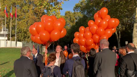 trafficking : STRASBOURG, FRANCE - OCT 18, 2018: Permanent Representation of the Netherlands balloon launch in front of Council of Europe inauguration of the exhibition Open Your Eyes to Human Trafficking
