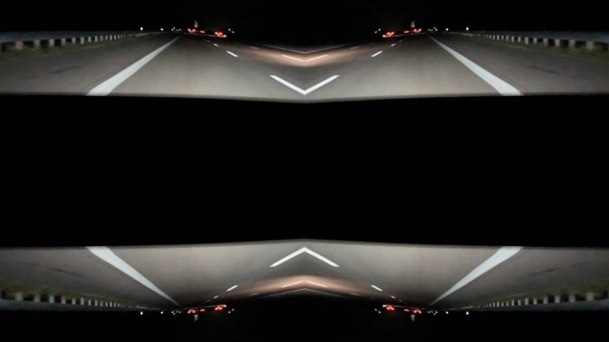 sahte : Abstract inception effect - view of the driver at German autobahn with mirrored mind bending sci-fi video manipulation during night drive POV Stok Video