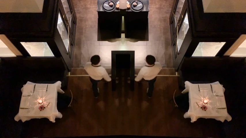 irreal : BADEN-BADEN, GERMANY - CIRCA 2018: View from above of the iconic PorterHouse porter house grill restaurant in central Baden-Baden with waiter exits door - inception mirror sci-fi effect Stock Footage