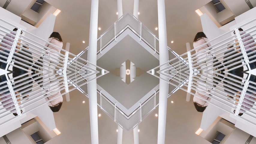 manipulace : BADEN-BADEN, GERMANY - CIRCA 2018: Interior view of Museum Frieder Burda stairs with the inception mirrored mind bending sci-fi video manipulation showing stairs and people silhouettes discovering the outer parallel world symmetric world Dostupné videozáznamy