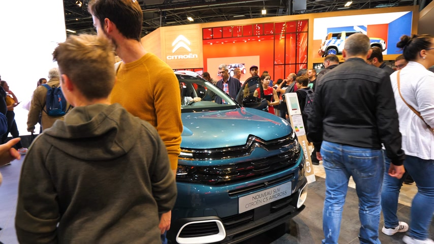 citroen : PARIS, FRANCE - OCT 4, 2018: Customers curious people admiring new luxury  at International car exhibition Mondial Paris Motor Show taking photo Stock Footage