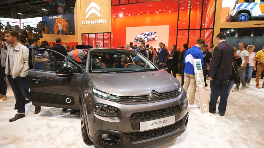citroen : PARIS, FRANCE - OCT 4, 2018: Customers curious people admiring new brown luxury Citroen C3 at International car exhibition Mondial Paris Motor Show admiring the car stand