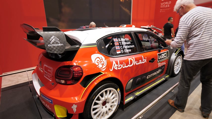 citroen : PARIS, FRANCE - OCT 4, 2018: Customers curious people admiring new sport rally Citroen C2 WRC at International car exhibition Mondial Paris Motor Show,