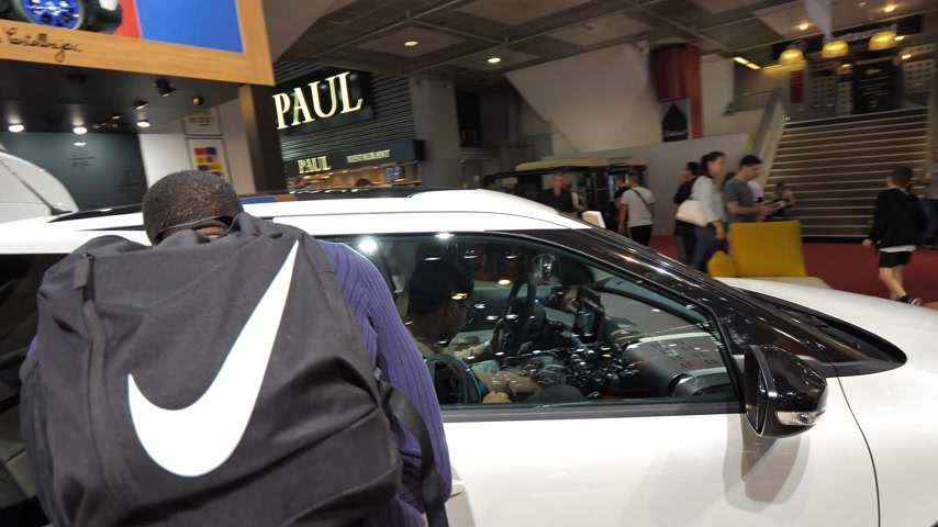 citroen : PARIS, FRANCE - OCT 4, 2018: Customers curious people admiring new new white Citroen Cactus SUV at International car exhibition Mondial Paris Motor Show