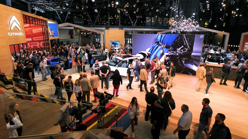 citroen : PARIS, FRANCE - OCT 4, 2018: Elevated aerial view of hundreds of customers curious people admiring new luxury Citroen mini car at International car exhibition Mondial Paris Motor Show