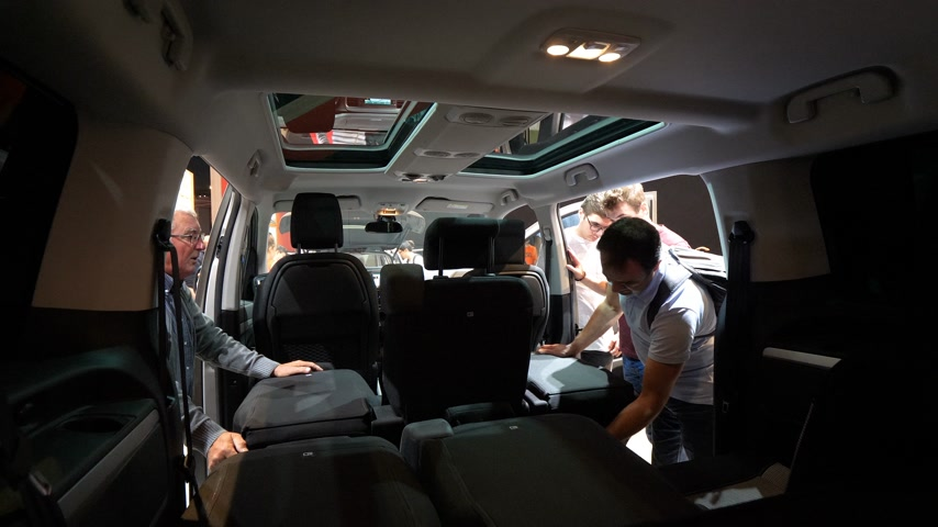 citroen : PARIS, FRANCE - OCT 4, 2018: Customers curious people admiring the interior and seat configuration of new Citroen Berlingo utility van at International car exhibition Mondial Paris Motor Show