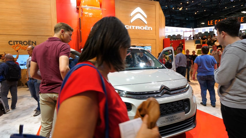 citroen : PARIS, FRANCE - OCT 4, 2018: Customers curious people admiring new French Citroen Berlingo utility van at International car exhibition Mondial Paris Motor Show