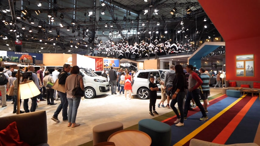citroen : PARIS, FRANCE - OCT 4, 2018: Wide angle view of customers curious people admiring new luxury cars at Citroen car maker stand at International car exhibition Mondial Paris Motor Show,