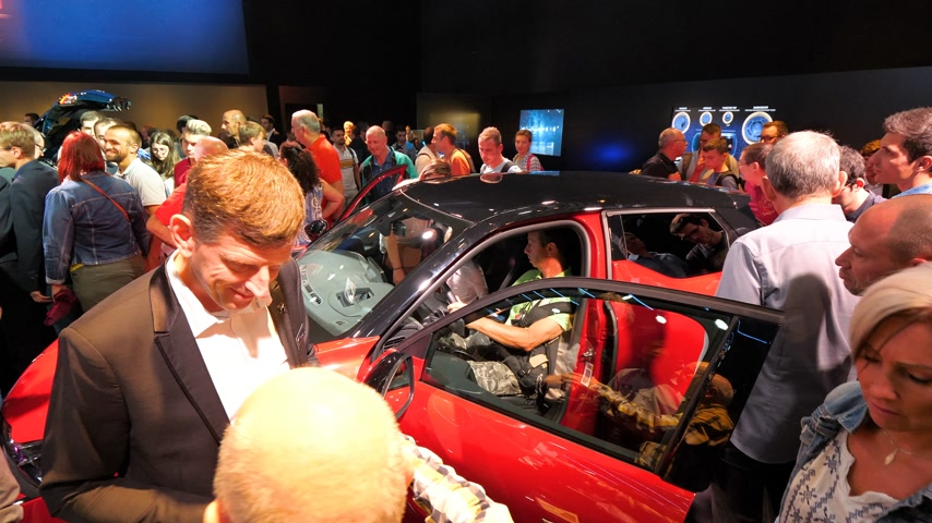 citroen : PARIS, FRANCE - OCT 4, 2018: Car business dealer selling new car as customers curious people admiring new luxury red Citroen at International car exhibition Mondial Paris Motor Show