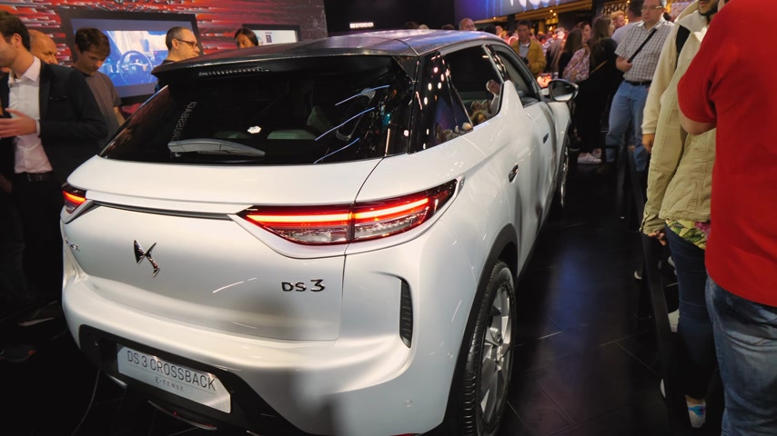 citroen : PARIS, FRANCE - OCT 4, 2018: Customers curious people admiring new French Citroen DS 3 Crossback e-Tense electric car exhibition Mondial Paris Motor Show