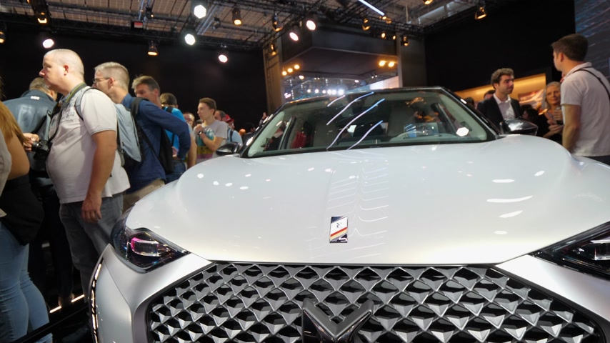 citroen : PARIS, FRANCE - OCT 4, 2018: Tilt to the logotype of new French Citroen DS 3 Crossback e-Tense electric car exhibition Mondial Paris Motor Show