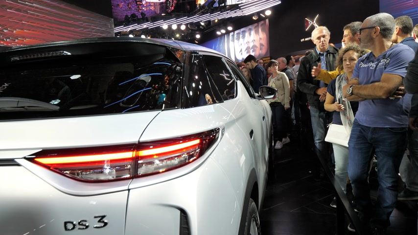 citroen : PARIS, FRANCE - OCT 4, 2018: Customers curious people admiring new French Citroen DS 3 Crossback e-Tense electric car exhibition Mondial Paris Motor Show man opens door handle