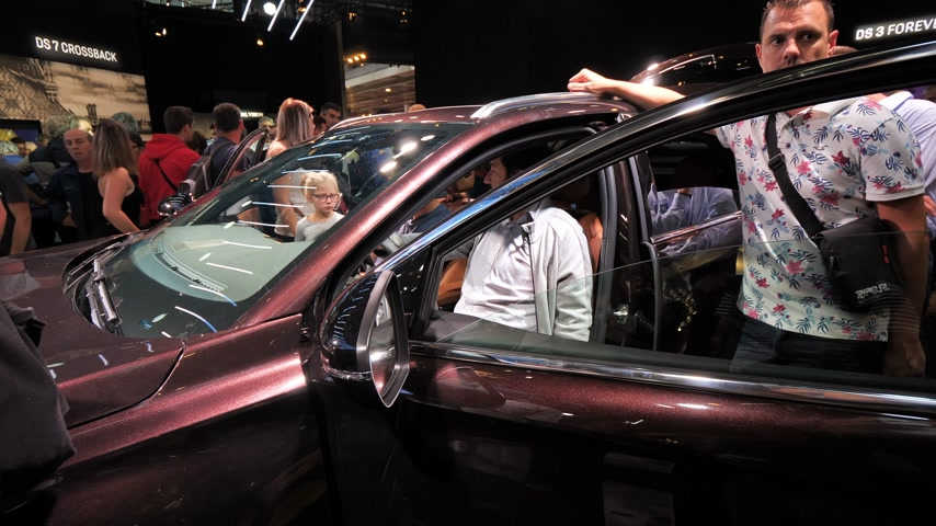 citroen : PARIS, FRANCE - OCT 4, 2018: Customers curious people admiring the interior of luxury Citroen SUV DS 7 Crossback at International car exhibition Mondial Paris Motor Show glass refection