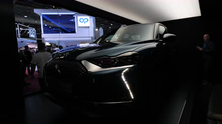 citroen : PARIS, FRANCE - OCT 4, 2018: Customers curious people admiring new new luxury Citroen SUV DS 3 Crossback at International car exhibition Mondial Paris Motor Show, illumination strobe effect