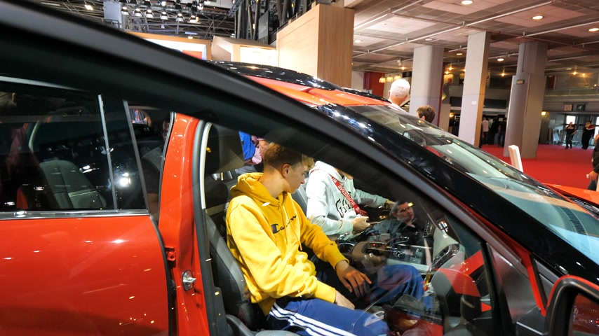 citroen : PARIS, FRANCE - OCT 4, 2018: Young curious boys inside and people outside the car admiring new luxury Citroen SUV c5 Aircross at International car exhibition Mondial Paris Motor Show,